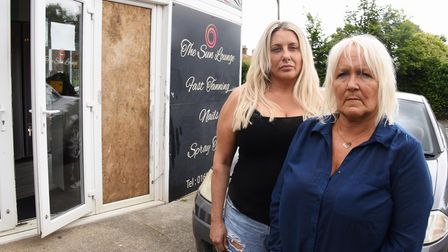 Owner Michelle Gallagher, left, and assistant Lynn Rennie, by the damaged door at the Sun Lounge on