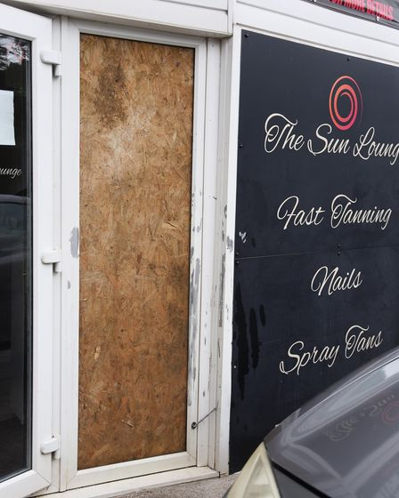 The damaged door at the Sun Lounge on Hall Road after the second arson attack on the premises. Pictu