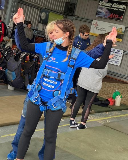 Demi-Leigh Harman being instructed on the freefall manoeuvres.