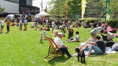 Families and local residents enjoying the sunshine at Royal Wharf.