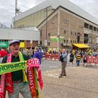 A half-and-half scarf seller outside of Carrow Road as fans arrive for the game against Liverpool