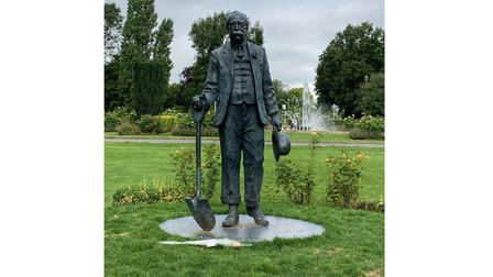 The statue ofSir Ebenezer Howard in Welwyn Garden City where a rose has been left with the words'RIP Aunt Sally'