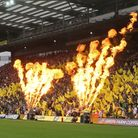 Pyrotechnics and flag waving create a great atmosphere before the Premier League match at Carrow Roa