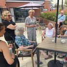 Angela Rippon sharing a chat and a smile with a group at Debden Grange Retirement Village, Newport, Essex