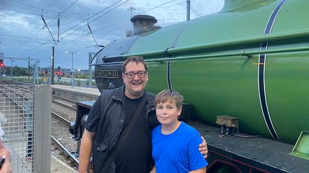 Chuffed rail enthusiast Kevin Drake with his nephew Liam and the Mayflower