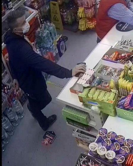 Detectives investigating a robbery in Kilburn are appealing for the public's help to identify three men