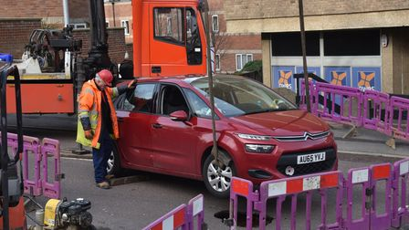 Car in sinkhole on Rouen Road is lifted out. Picture: ANTONY KELLY
