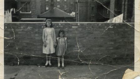 Mary and her younger sister pictured in the back yard of their Glasgow tenement in 1965.