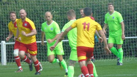 Action from the memorial football match which raised £550for the SOS bus charity.