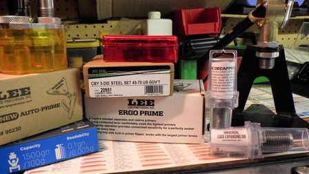 A selection of primers on a table to be used for reloading bullets