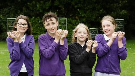 Winners Jenna, Henry, Oliver and Isabelle with their trophies from David Wilson Homes