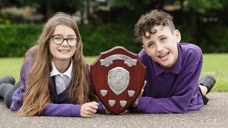 Horsford Primary School pupils Jenna and Henry with the school shield