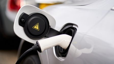 File photo dated 5/3/2021 of an electric car being charged. Electric car owners should be incentivis