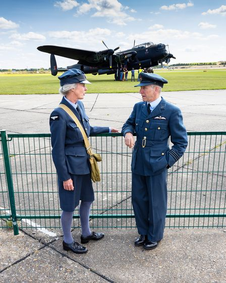 Re-enactors with the BBMF Lancaster behind them at IWM Duxford.