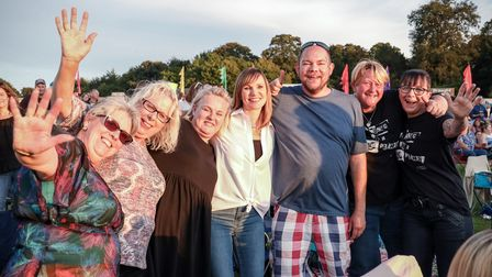 Groups of friends happy to be out enjoying the sunshine and the music again at the Heritage Live concert at Audley End