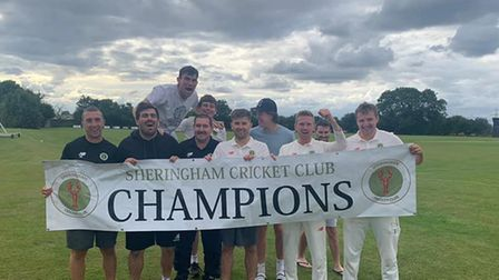 Sheringham Cricket Club's first team celebrate after wrapping up the league title against Swardeston CEYMS