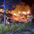 Large fire at side of road, firefighters in attendance, Great Sampford, Essex