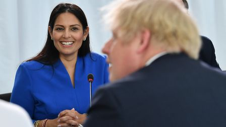 Home Secretary Priti Patel with Prime Minister Boris Johnson as he chairs a cabinet meeting. Photogr