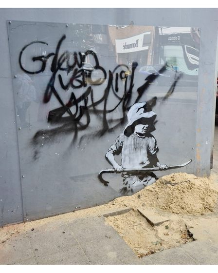 The protective screen installed on the Banksy artwork on London Road North in Lowestoft.