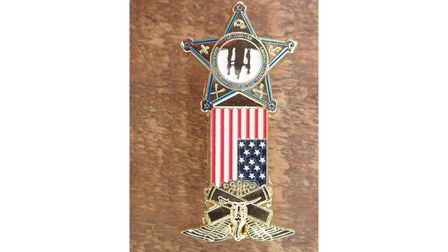 A replica medal created by Gina Costin
