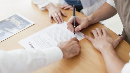 Prenup contract being signed at Ince Solicitors, London