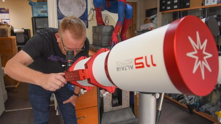 Ian Knight, co-owner of Altair Astro on Red Lion Street in Aylsham, looking through an Altair 115 te