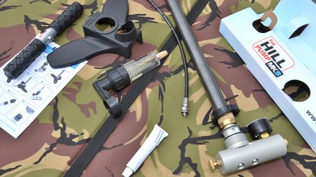 All component parts of the Hill Mk5 Airgun Pump, laid on camo on a table