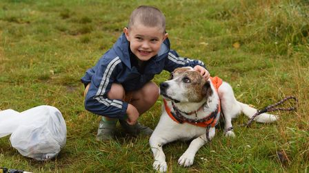 Seven-year-old George Goode out litter picking at Mousehold Heath, to help rescued animals and save