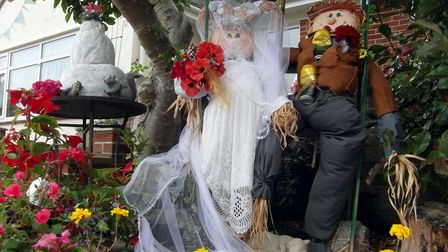 A scarecrow bride-and-groom which are part of thetrail in Cheddar.