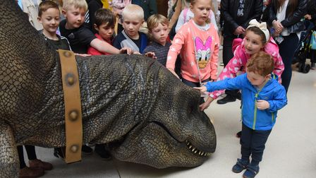 Children get close to the T Rex called Donald at the Castle Quarter. Picture: DENISE BRADLEY