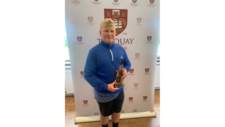 Young golfer with award