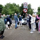 Residents point to the new No Right Turn sign at the top of Swains Lane