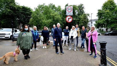 Residents at the new No Right Turn sign at the top of Swains Lane