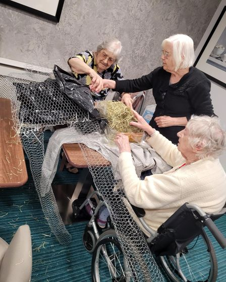 Those living at Barchester, The Warren Care Home working on their scarecrow for the trail