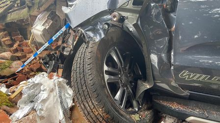 A mangled wheel from the destroyed vehicle.