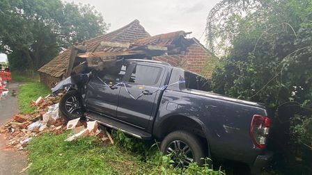 The wrecked pickup truck.