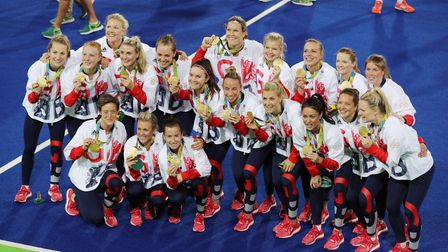 Alex Danson (kneeling, centre) and the GB team celebrate with their Olympic gold medals atRio 2016