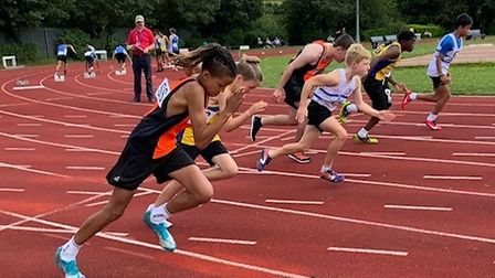 Joshua Wright (nearest the camera) of Stevenage & North Herts AC in the Eastern Young AthleticsLeague.