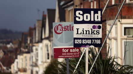 File photo dated 23/01/15 of For Sale and Sold signs outside houses in north London. The average num