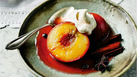 A dish of peaches poached in Muscat wine with clotted cream