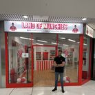 Founder of the Land of Munchies, Louis Norris, stands outside his newest Romford store.