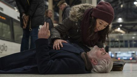 Eve (Sandra Oh) and Konstantin (Kim Bodnia) at Liverpool Street beside a Greater Anglia train in Killing Eve.