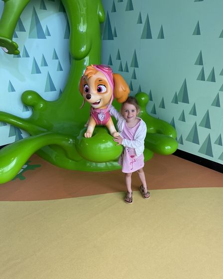 child with skye from paw patrol