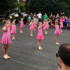 Young girls in pink outfits in Tiny Tempos group performing at Newport village fete, Essex