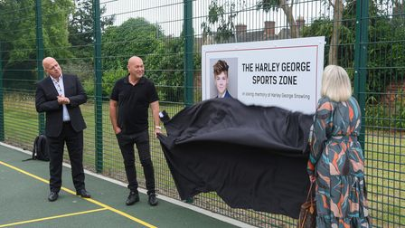 Karen and Harvey Snowling unveiling The Harley George Sports Zone at Colville House in Lowestoft in