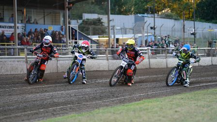 Riders race for the first bend in the opening heat.