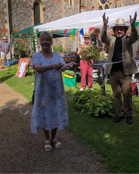 Carol Bundock opens the church fete with the Revd James Stewart pictured on the right