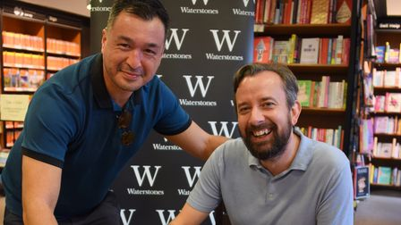 Author Owen Nicholls signs his second book, Perfect Timing, for James Carter at Waterstones. Picture