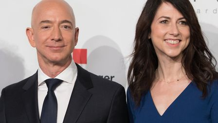 Amazon CEO Jeff Bezos and his then wife MacKenzie Bezos poses as they arrive at the headquarters of