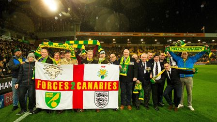 Forces2Canaries members pictured at Carrow Road. Chairman Neville Townsend is seventh from right